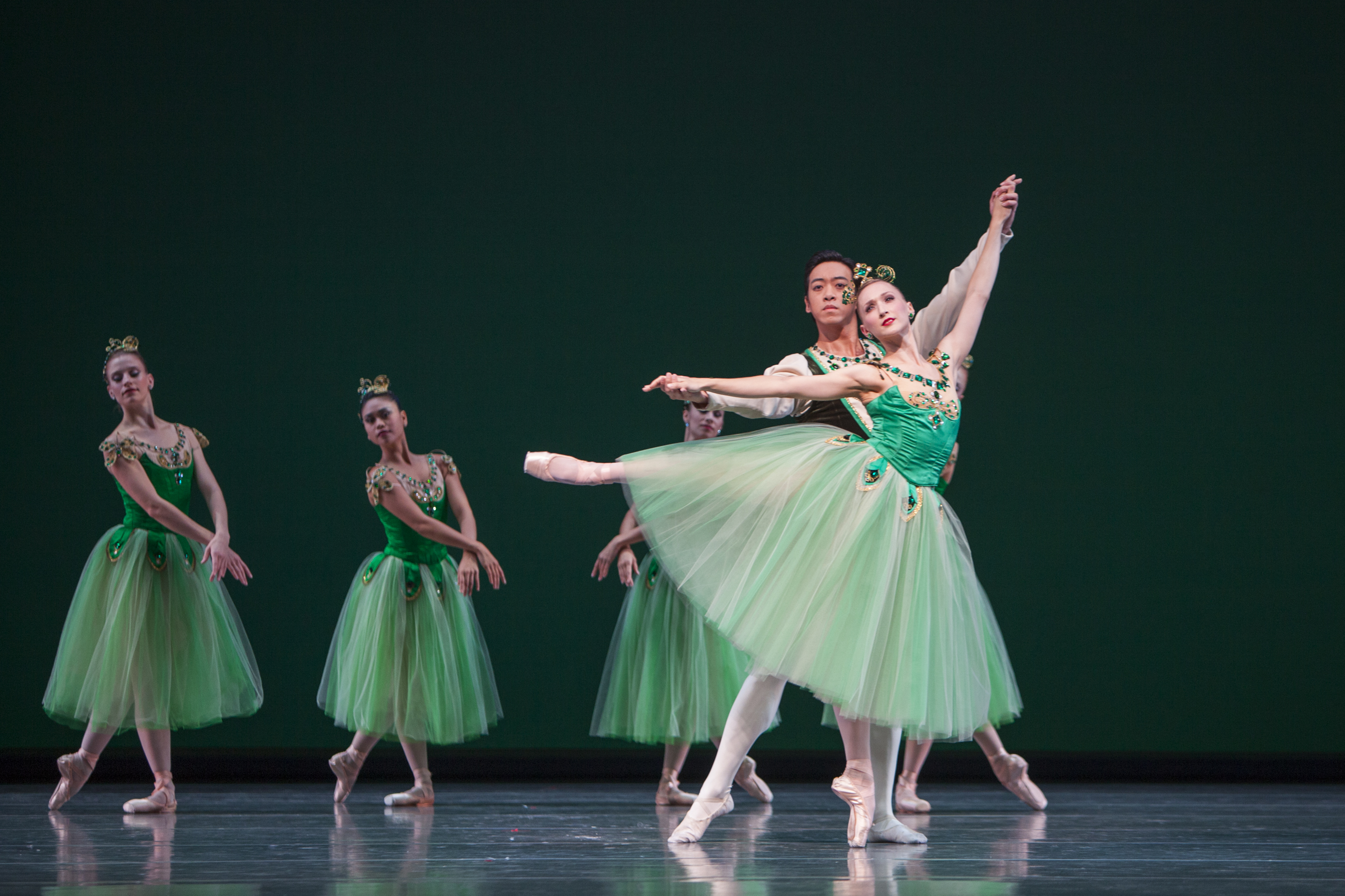 Pacific Northwest Ballet soloists William Lin-Yee and Elizabeth Murphy with company dancers in Emeralds Photo by Angela Sterling