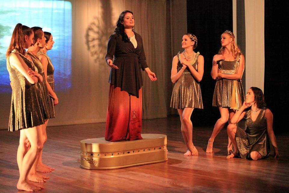 Actor Ana Maria Campoy with dancers in Gifts of War Photo by Lionel Flynn